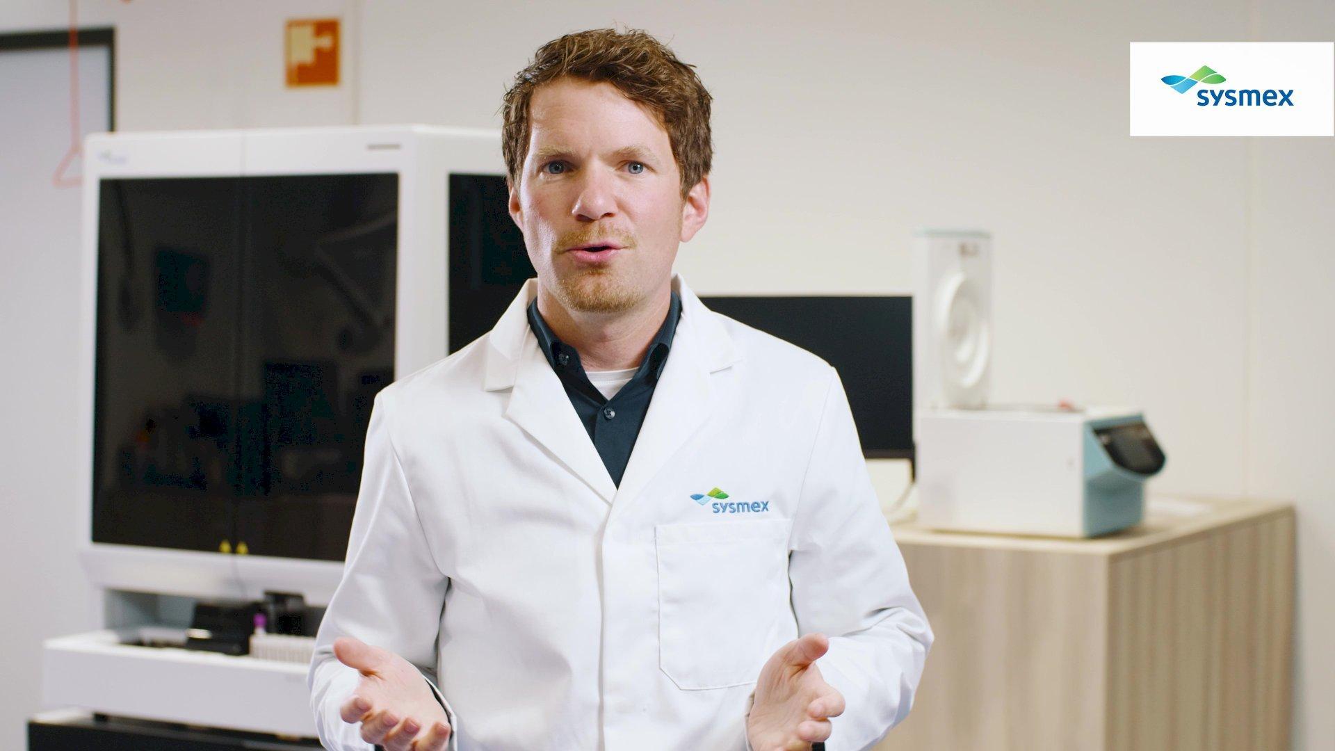 Laurens vertelt over het pipetteerstation voor de flowcytometrie